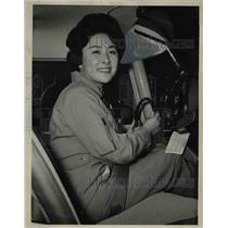 1963 Press Photo Captain Kyung O Kim is shown at the controls of training plane
