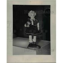 1937 Press Photo A small doll figurine on display