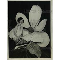 1925 Press Photo Mary McIntyre with a huge magnolia blossom