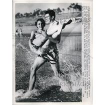 1951 Press Photo of Mike McCoy 17 and Paula Partridge 16 playing at the beach.