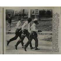 1970 Press Photo Policemen Chase Students at Pontiac Central High School