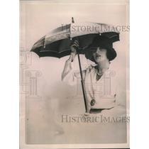 1922 Press Photo Parasol of blue satin & green ribbons