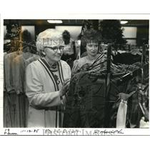 1985 Press Photo Elsie Bodvin (left) selects a new outfit for a contest.