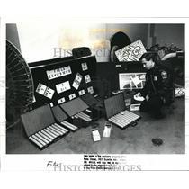 1989 Press Photo Euclid Patrolman Robert Trueman on confiscated gambling tools