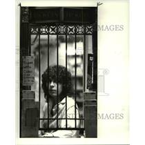 1986 Press Photo Judy Kirk waits behind the window for customers at Lotto Window