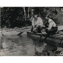 1923 Press Photo Men feeding fish in a nursery pond