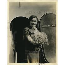 1934 Press Photo Mary Parker with First Daffodils of Spring