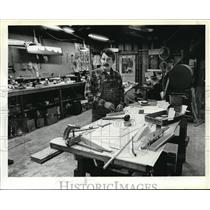 1983 Press Photo Manufacturer Gregory R. Ernst works on model airplane kit