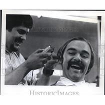 1973 Press Photo Larry Burbach police patrolman haircut by Garry Johanneses