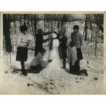 1930 Press Photo Girl Scouts Make Snowman