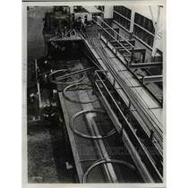 Press Photo Machines redraw straight wire into coils at a plant