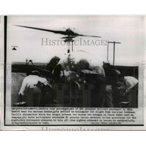1954 Press Photo Passenger of Stranded Train in Helicopter