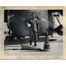 1961 Press Photo of Rodney J. Smith in front of the helicopter that retrieved