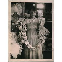 1921 Press Photo Woman & soft fabric for making baby shoes