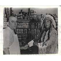 1941 Press Photo Montana Chief Max Big Man buys defense stamps for Crow tribe
