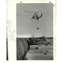 1979 Press Photo Helicopter Lifts On of Three Duck Hunters From Breakwater
