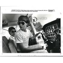 1991 Press Photo Ethan Dwyer at the controls of a Cessna Cutlass RG