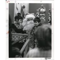 1977 Press Photo Children enjoying Santa's presents