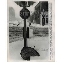 1961 Press Photo A battered umbrella abandoned against a stop sign - nee03551