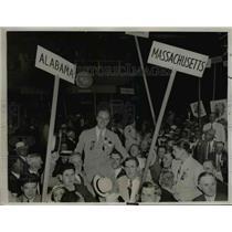 1930 Press Photo Delegates raise member James Roosevelt son of pres.