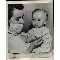 1948 Press Photo Infant Beverly Smith Insensitive to Pain, Nurse Helen Zimmerman
