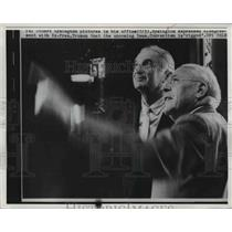 1960 Press Photo Stuart Symington shows pictures in his office to expres. Truman
