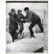 1956 Press Photo James Preston hands his son Mike to a coast guardsman on a dock