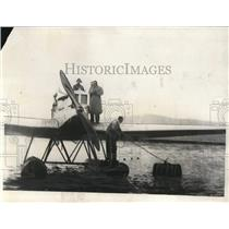 1929 Press Photo of Swedish fliers refueling their aircraft in Reykjavik Harbor.
