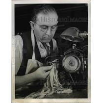 1944 Press Photo A man working with chinchilla furs to make clothing