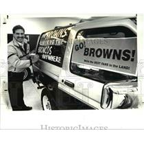 1987 Press Photo Cliff Weber with the Bronco banners