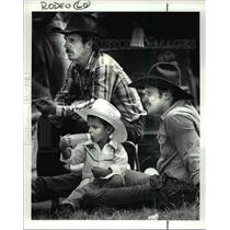 1987 Press Photo Two year old Win Likert while watching the rodeo with his dad