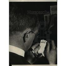 1925 Press Photo A man holding a hand of cards
