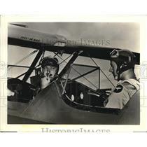 Press Photo Plane Flying Instructor, Student Talk in Cockpit Intercom System