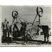 1932 Press Photo Pilot William Campbell attempting to land flipped over plane