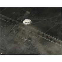 1926 Press Photo of an airplane brought safely to the ground with a parachute.