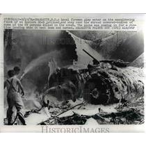 1974 Press Photo Local firemen spray water at the ruins of Eastern DC 9 jetlined
