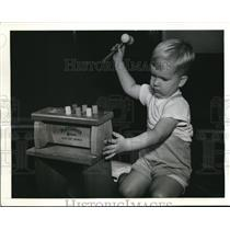 1942 Press Photo Baby plays with new Toy Set