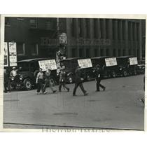 1930 Press Photo Cleveland press trucks with ads on the sides