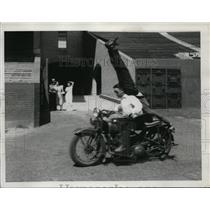 1923 Press Photo two men performing motorcycle stunt