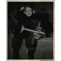 1949 Press Photo Mario Bats examines model airplane carries him to San Francisco