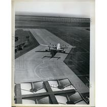 1962 Press Photo Oakland Calif 4 motor prop plane on 10,000 ft runway