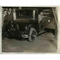 1931 Press Photo The owner of the gas station in his almost wrecked business