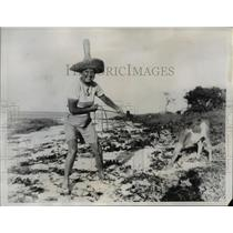 1935 Press Photo of Georgia Coleman with a calf in Nassau, Bahamas. - nee44707