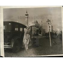 1929 Press Photo Woman stands outside car in Opa Lacka FL