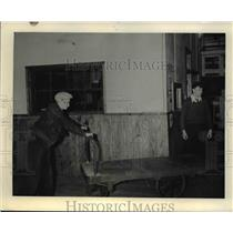 Press Photo Plant Worker Pushing Electric Hand Truck  - nee42360