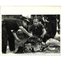 1983 Press Photo Cleveland Policeman & Fireman at crash site in Hopkins airport