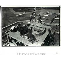 1987 Press Photo Iron workers on top of the new Control Tower at Hopkins