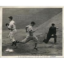 1941 Press Photo Indians catcher Rolly Hemsley out at 1st vs John Sturm