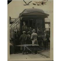 1924 Press Photo Paderowski car of a train & som men at a meeting