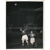 1941 Press Photo J Skiba of Brookhattans bounces ball high off his head